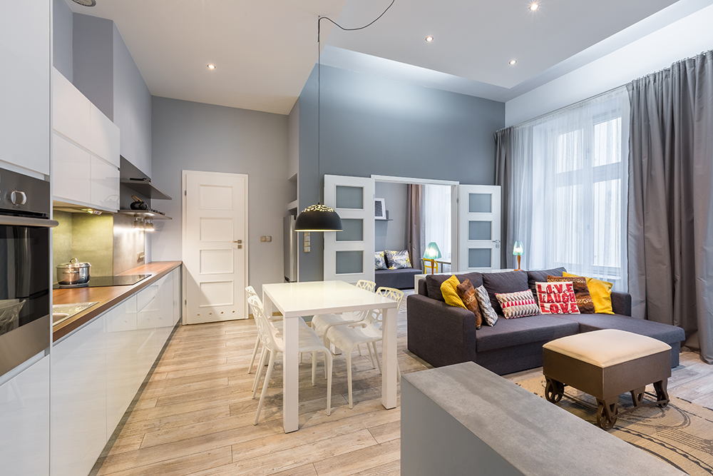 Contemporary apartment with dining table, open kitchen and living room